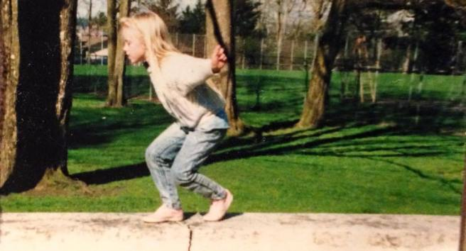 baby tay walking on a ledge